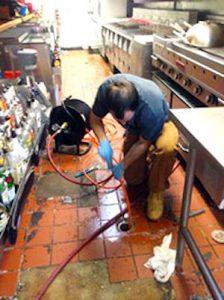 Toronto plumber unclogging drain